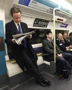 british_prime_minister_david_cameron_standing_on_a_train.
